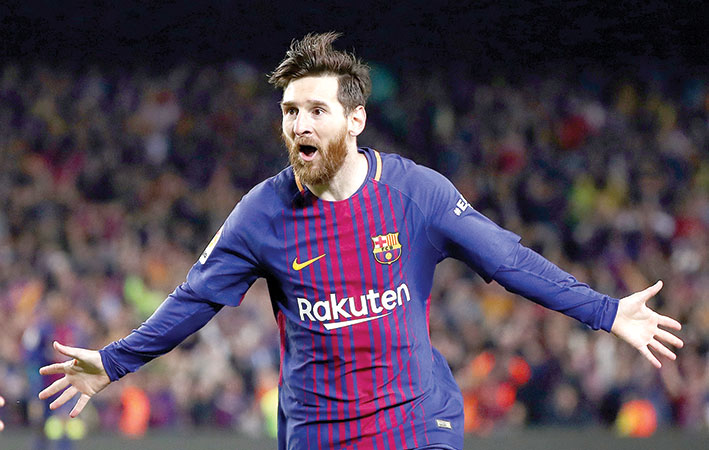 كرة قدم / البطولات المحلية الأوروبية - ميسي يظهر وبرشلونة ينتصر ويعود للصدارة
