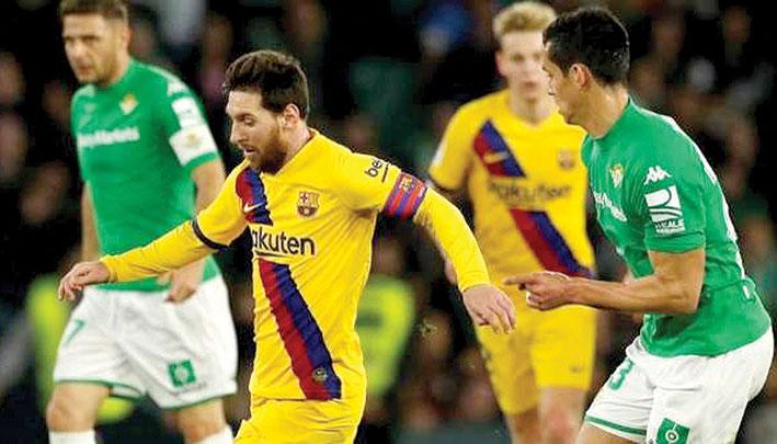 البطولات المحلية الأوروبية لكرة القدم برشلونة يحقق فوزاً صعباً على بيتيس